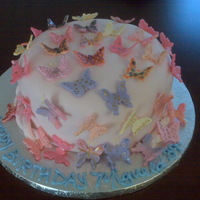 "Butterfly Kisses 8"" Dominican Cake, dominican icing, covered with fondant,,everything edible..tfl!! Cust very happy ;)"