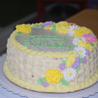 Basketweave Birthday Lemon White Chocolate cake and frosting with lemon filling. Royal icing flowers.