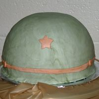Army Helmet Cake was half of ball pan, with fondant icing. Design inspired by other fabulous helmets here on CC.