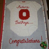 Osu Baby Buttercream Icing, with homemade buckeyes in the corner. This cake was really fun to do.