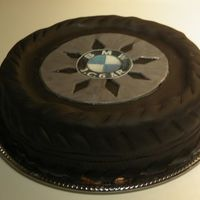 Tire chocolate cake with chocolate bc and fondant, printed edible image