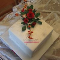 Roses And Snowflakes   here is the cake with the bouqet on it