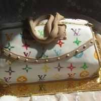 Lv Purse Cake  I made this purse for a 14 year old girl today. Inside is light sponge with strawberries and chocolate chips in cream whipped with...