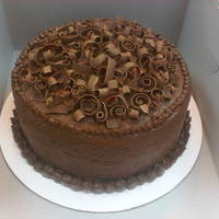 Chocolate Cake W/ Chocolate Curls I made this for my boyfriend's sister. She made it into the nursing program at Alabama and is headed back to start today. She loves...