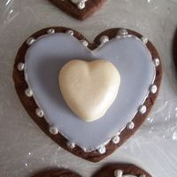 Lavender Heart Cookie inspiration from Peggy Porschen--chocolate rolled cookie with royal icing, Toba's glace, white chocolate fondant and luster dust.
