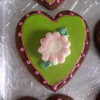 Green Heart Cookie inspiration from Peggy Porschen--chocolate rolled cookie with royal icing, Toba's glace, white chocolate fondant and sparkle dust.