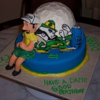 Notre Dame Golf Cake Birthday cake for a Notre Dame fan. He is also an avid golfer so they asked if i could combine both of his loves. MMF covering bottom layer...