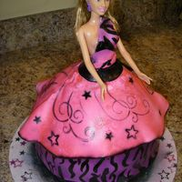 Punk Rock Barbie Doll Cake Punk Rock Barbie cake done in fondant hand painted zebra print then airbrush on everything else. 1st time doing a barbie cake i used a...
