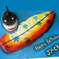 "Surfboard And Shark Surfboard and Shark cake. The surfboard is 27"" long. Surfboard is white cake covered in MMF and Shark is red velvet covered in MMF."