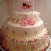 Rest Lil Baby Stacked cake with pink, purple, and yellow flowers.