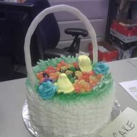 Easter Basket 8 in. cake with basket weave design. Fondant wire handle. decorated with peeps and jelly beans.