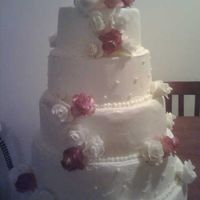 Traditional Wedding Cake Stacked wedding cake with basic designs and fondant flowers.