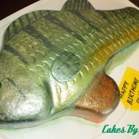 Fish Cake Fondant hand painted and then airbrushed with silver sheen