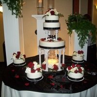 Black And White With Red Roses This is a wedding cake I did for my brother. The roses are real flowers.