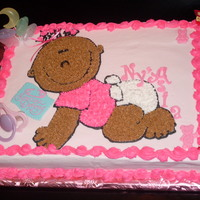 It's A Girl This cake is a yellow cake with Buttercream icing and has a pacifier and a bow in the baby's hair. Hand Drawn and had other accents to...