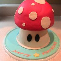 Img_0382.jpg Boys birthday. Mario Brother's one up mushroom cake.. This turned out better than expected. The boy and his mom were pleased.