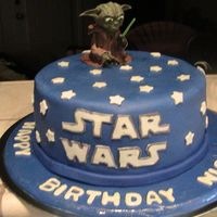 Img_0438.jpg Star wars cake for boy. Got idea from photostream. Yoda was made from gumpaste and took me a long time to sculpt.