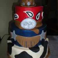 Cowboy Themed Cake Made this three tiered cake for boys birthday. Hat on top was small cake.