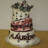 Lauren's Graduation Cake With a topsy turvy look, the stars and numbers are made of fondant.