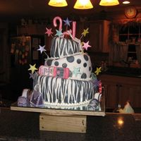 Alex's 21St Birthday Topsy Turvy..all fondant, including 6 high heel shoes, with matching purse. Pearl necklace, ring , cell phone, stars and 21 on top. My...