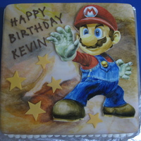 Super Mario Birthday Cake Entirely handpainted Mario on gumpaste. Took me approx. 5 hours to paint it. I'm quite happy with the result.