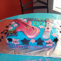 Camp Rock Cake Made this cake for my friend's eight year old daughter.All covered in fondant, guitar and mic are fondant paint with lustre. I wasn&#...