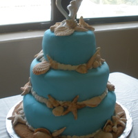 Wedding wedding cake,hand made decoration and fondant, not the toppercoconut, guava,and pineaple filling