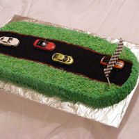 Race Car Cake I made this cake for my 5 year old nephews celebration party. We were celebrating the end of his chemo treatments & his full recovery...