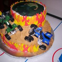 Dylan 7 This was my son's 7th birthday cake. He got his 4-wheeler on his birthday during the week. I had the picture printed on wafer paper 7...