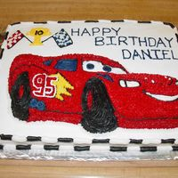 Lightning Mcqueen   Sheet cake bottom w/ novelty pan top, buttercream.