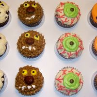 Creepy And Cooky Halloween Cupcakes Mummy, Werewolf, Eyeball, and Jack-O-Lantern Cupcakes