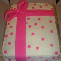 Pink Gift Cake   Cake is covered in White BC. The Bow , Ribbons, and Dots are MMF. This was my 1st time working with fondant of any kind.