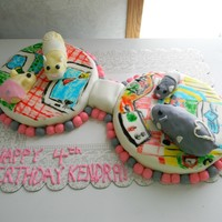 Zhu Zhu Pets   Fondant Covered RKT. Hand drawn floor with edible markers.