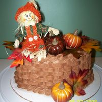 Harvest Cake course II final cake..I made it chocolate buttercream frosting..in the basket weave method.. I bought the leaves and pumpkins and the...