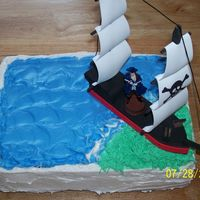 Pirate Cake 1st cake I made for my son...made with chocolate cake and whipped frosting. I bought the foam ship and assembled it so he could keep it...