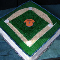 Baseball Field orange flavor cake, filled with mango jelly, cream cheese icing.