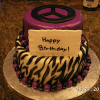 Zebra And Peace This cake was created by my daugther she drew it and I made for her 13th Birthday. The cake was chocolate with a rasberry filling and...