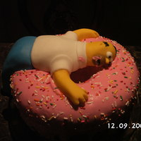 Homer Dream This was a cake for my son birthday who loves to watch the show. I made homer out of fondant that was realy hard.