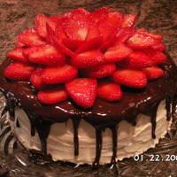 Strawberry Flower Cake Fresh strawberrys I dipped in strawberry glaze for a very shinney look.First time making a strawberry flower.This cake was for my husband B...