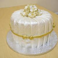 Pleated Cake Pleated fondant, gold ribbon, silcone molds for roses, gilded in gold.