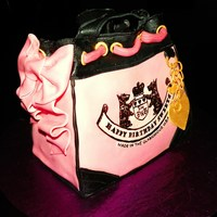 Juicy Couture Purse Cake  used loaf pan to bake cake then carved to get the desired shape, iced in bc, covered in mmf, accents in gumpaste. label made using edible...