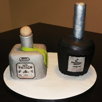"Hennessey And Patron Grooms Cake hennessey bottle made using 6"" round and carving to desired shape, iced in bc and bottle neck made using rice krispie treats covered..."