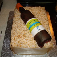 Wine Box Cake birthday cake made with an edible label on the wine bottle. bottle made of gum paste modeled around a real bottle. the surprise party was...