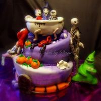 Nightmare Before Christmas Cake This was for my brothers BDay - 1st attempt at TT cakes and I made everything edible :) All my figures were fondant/gumpaste and made their...