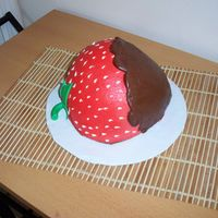 Chocolate Covered Strawberry ! Wondermold carved to strawberry, red BC, fondant leaves & stem, chocolate BC warmed and piped over. Would have covered choc with...