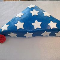 Folded Flag W/ Roses RBC flag with fondant stars and GP red roses. Really just did for my DH, I was wanting to do RBC again. I wanted to see how big of a piece...