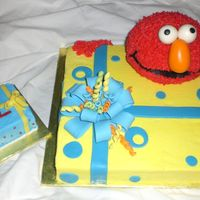 Elmo & Gift Box W/ Smash Lots of cake here ! 14 in sq( cut down some. used trimmings to make smash cake) and ball pan for Elmo. 1st GP bow, streamers and fondant...