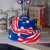 100_1480.jpg A 70th Birthday cake for a very patriotic man. Devil's food with chocolate truffle filling. 9in and 6 in. TFL