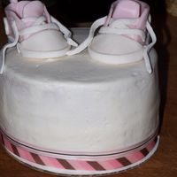 Baby Shoe Cake  Here is the cake that I put the shoes I already posted on top of. 6in lemon pound cake with vanilla bean cheesecake filling. My first time...