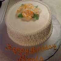Birthday Cake  BC white on white. with cornelli lace and ruffle border. I tipped the roses w/ a light orange color for fall. I think it would make a nice...